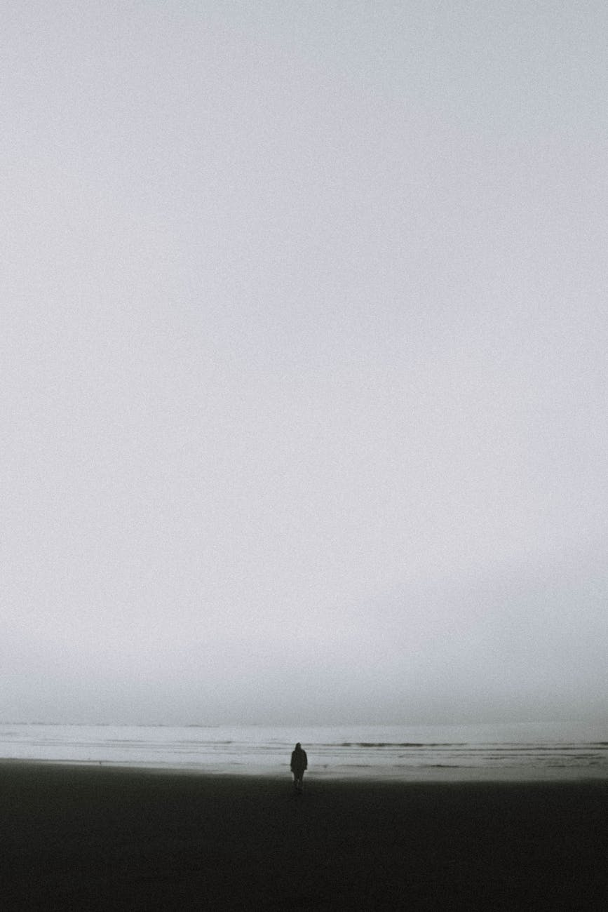 lonely person standing on seashore