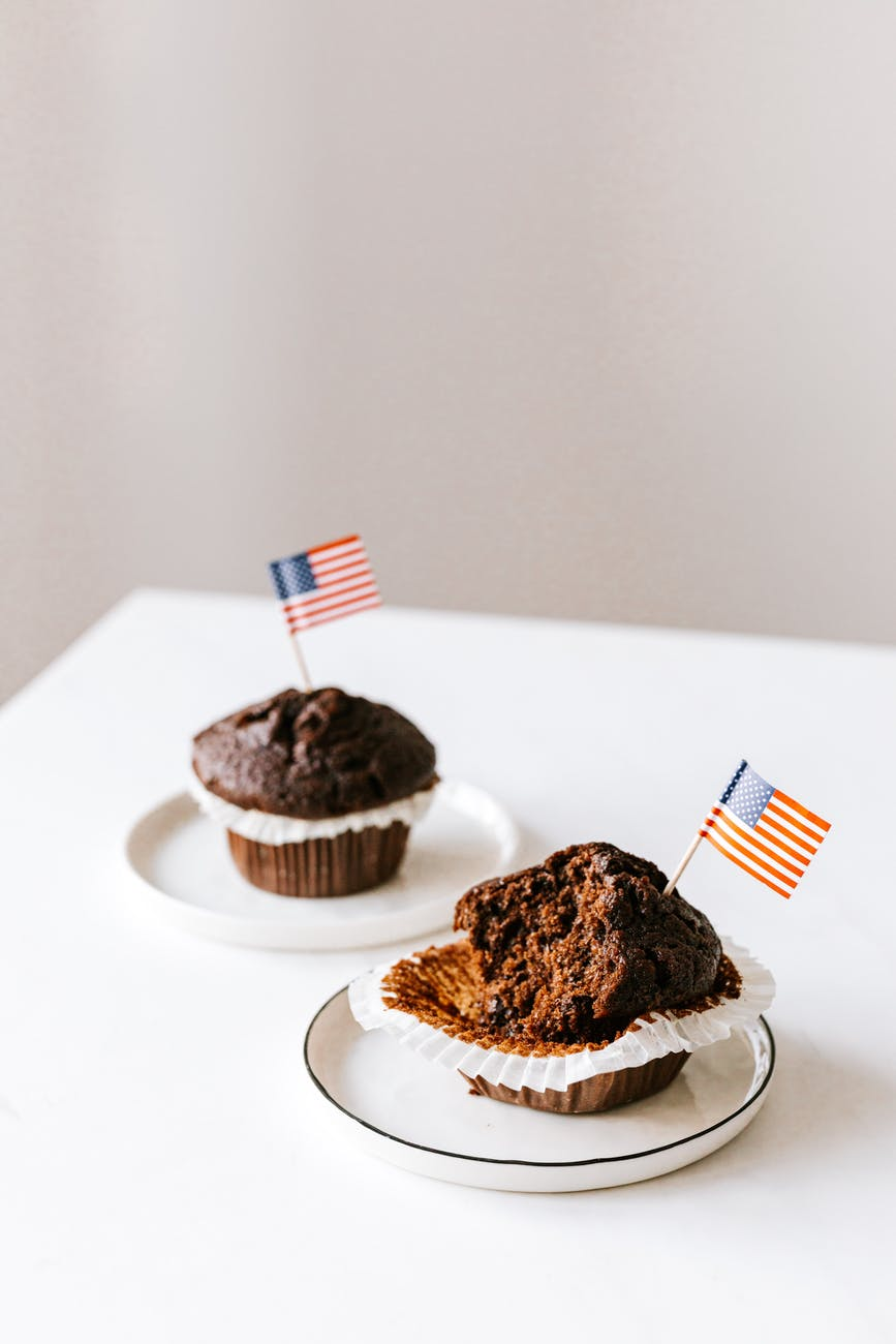 tasty festive muffins decorated with cocktail flags of united states